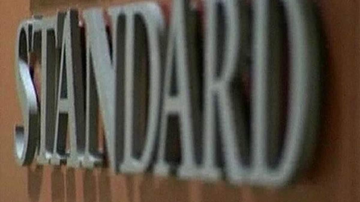 Standard&Poor's понизило рейтинг 11 испанских банков