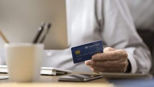 Хочешь, не хочешь–плати:банки начали списывать деньги со счетов украинцев за штрафы и коммуналку